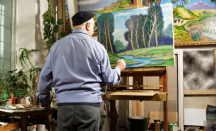 artist standing at easel