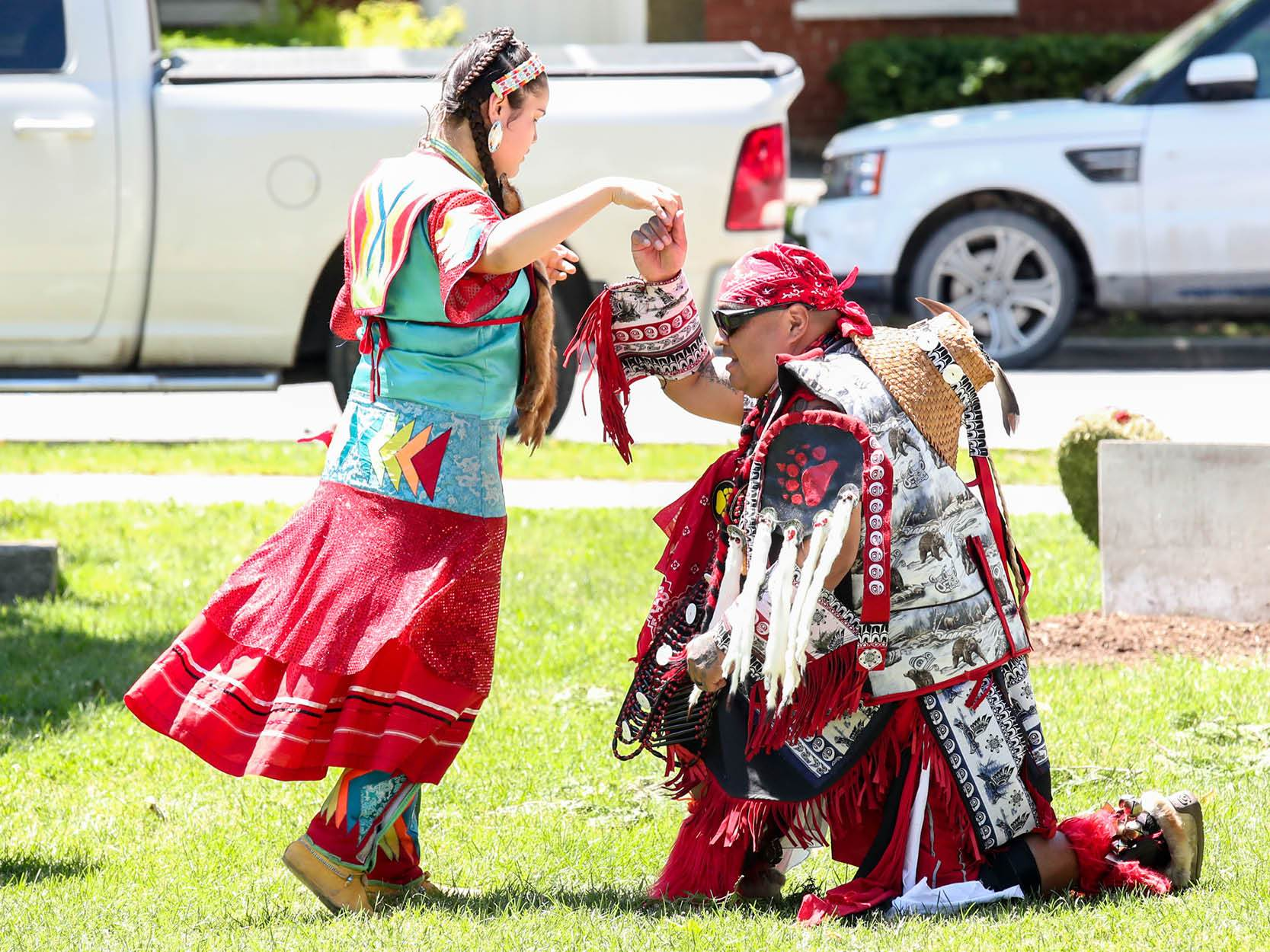 Two indigenous people dancing