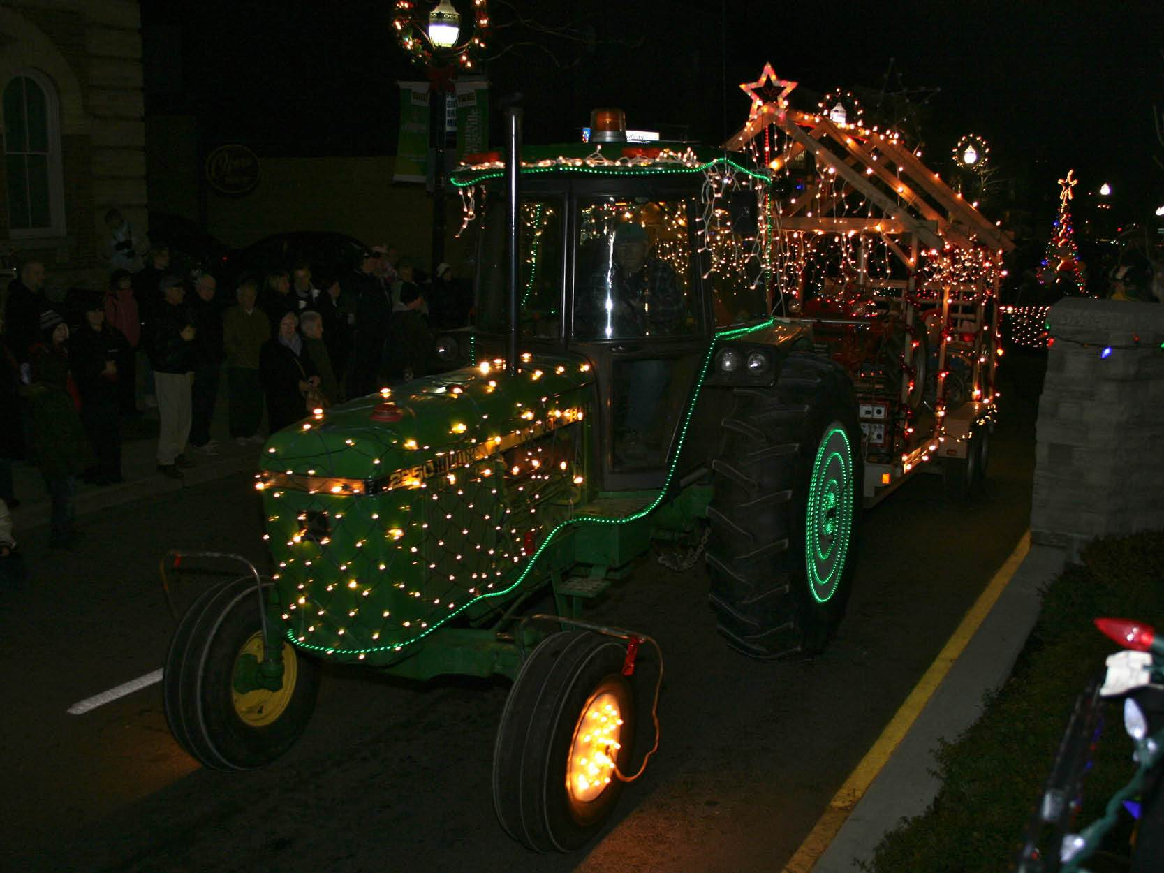 Tractor decorated in lights at night