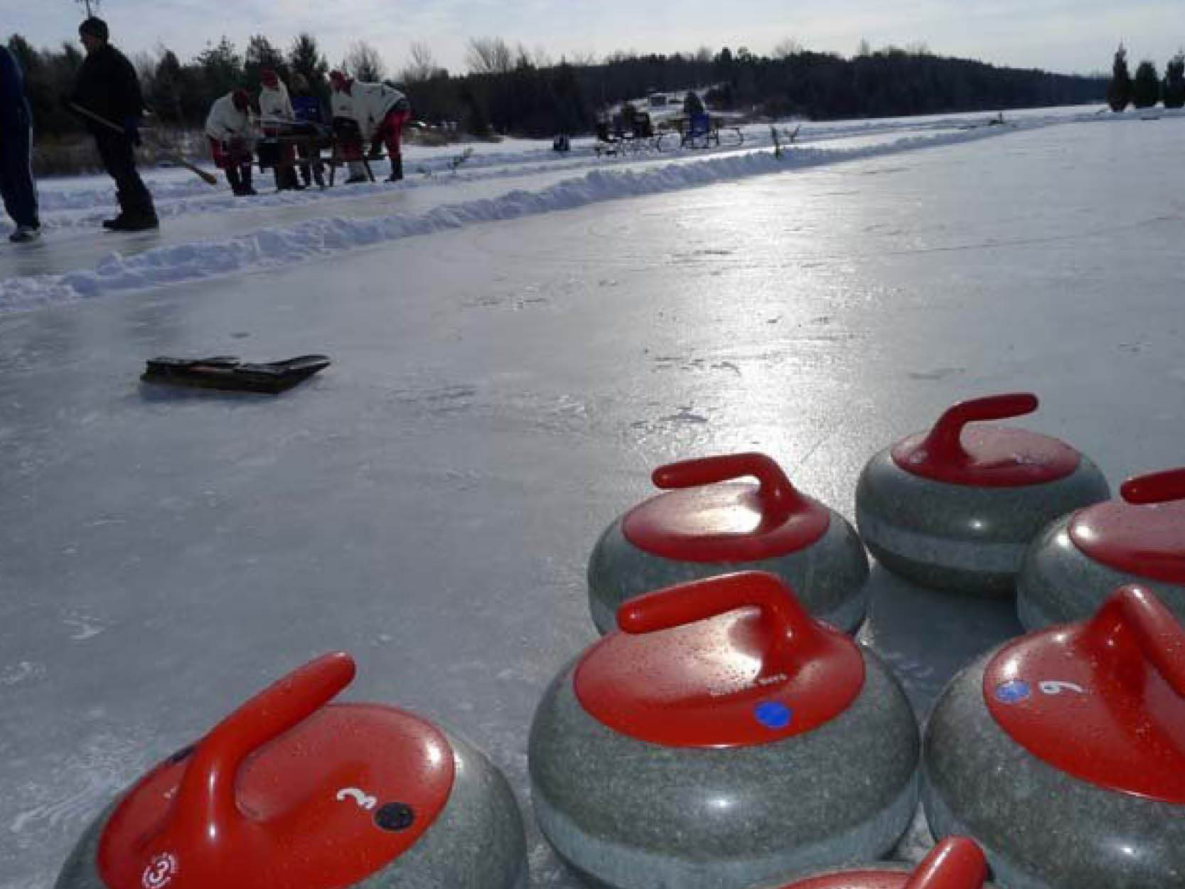 Curling stones on pond ice