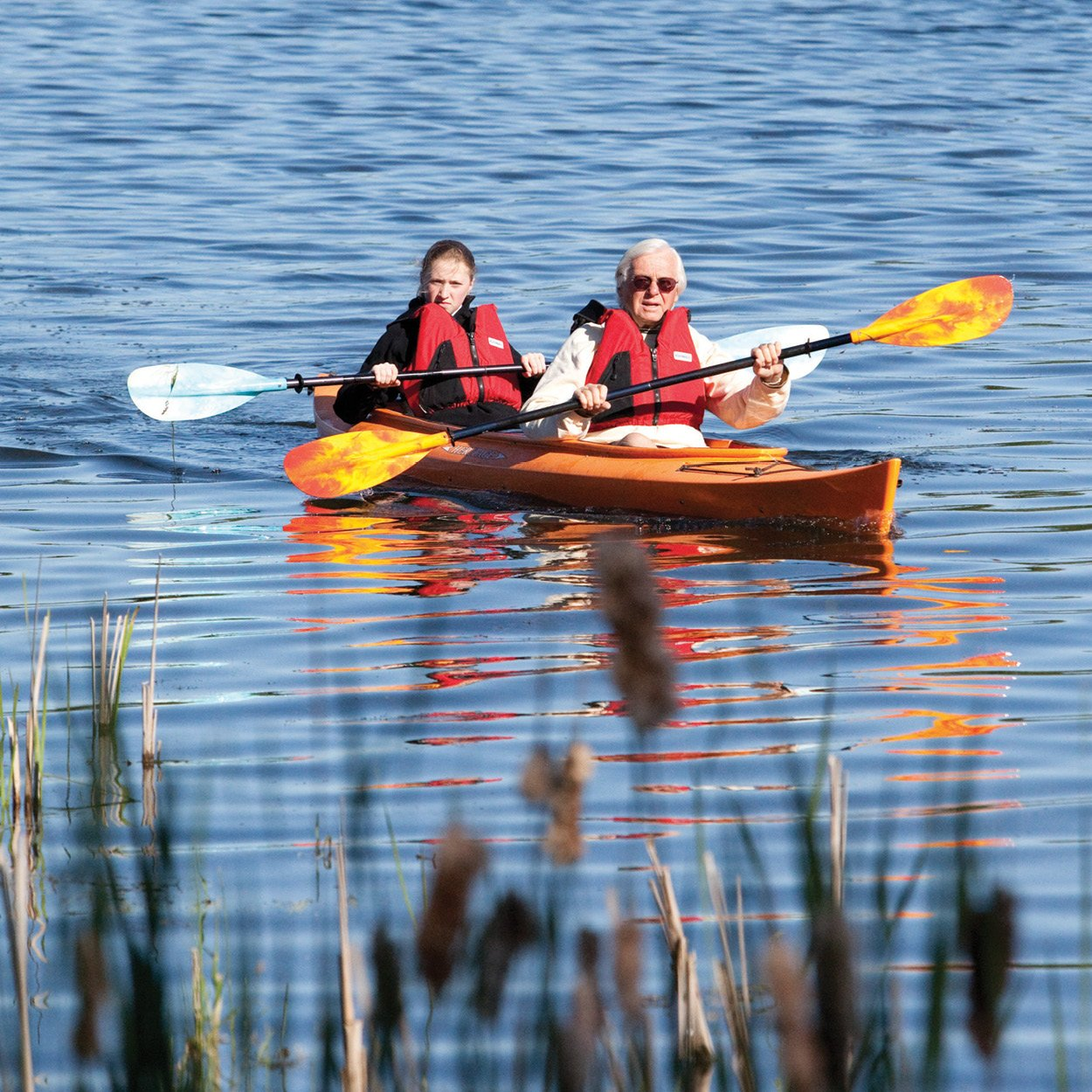 Two people in a kayak on a lake