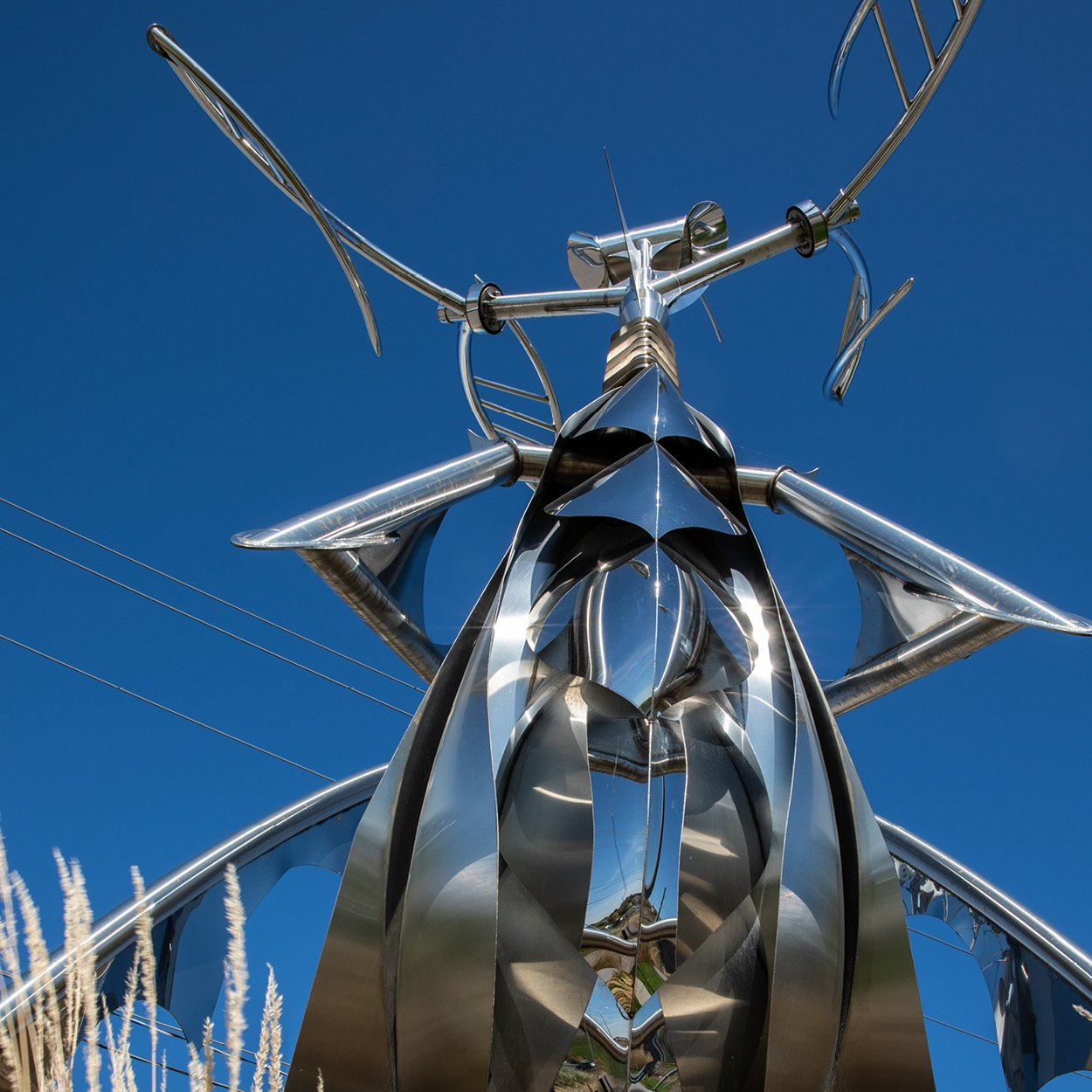 Large metal sculpture with blue sky